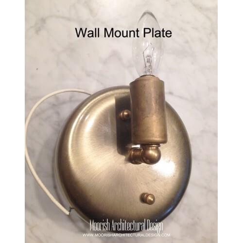 Filigree metal wall sconce