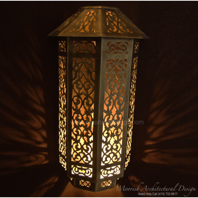 Filigree metal wall sconce